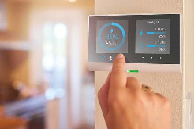 hand touching a smart meter